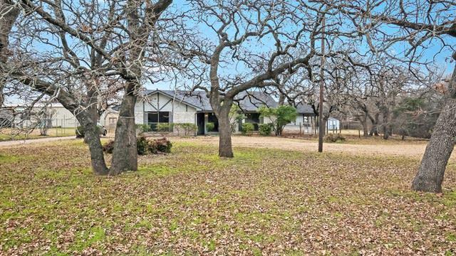 Photo 1 of 25 - 2808 Whispering Creek Ln, Burleson, TX 76028