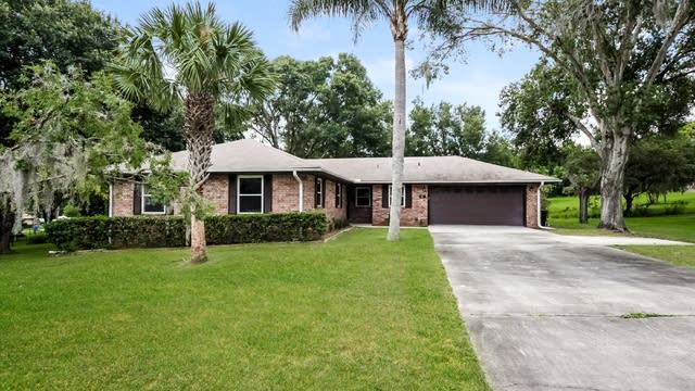 Photo 1 of 25 - 101 E Orchid Way, Howey In The Hills, FL 34737