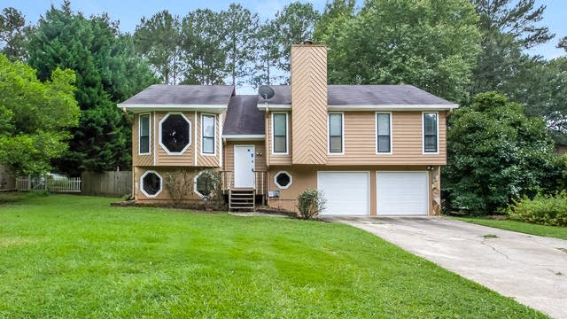 Photo 1 of 25 - 2821 Mountbery Dr, Snellville, GA 30039