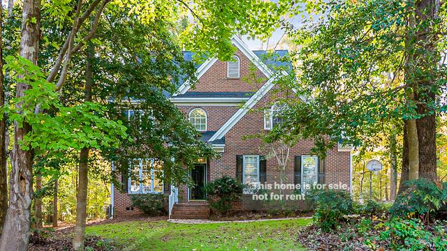 Photo 1 of 35 - 5013 Sunset Walk Ln, Holly Springs, NC 27540