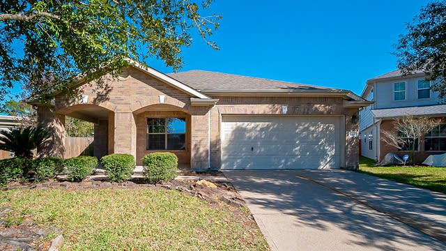 Photo 1 of 33 - 19822 Rippling Brook Ln, Tomball, TX 77375