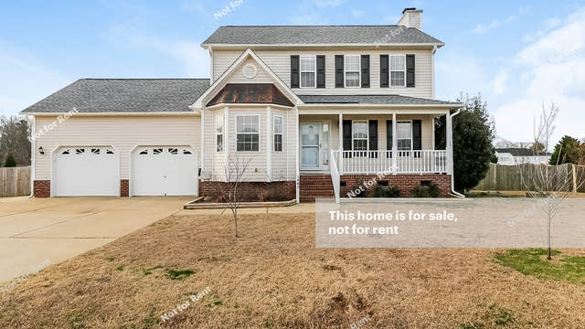 Photo 1 of 25 - 1405 Brittany Wood Dr, Willow Spring, NC 27592
